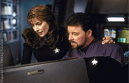 Troi and Riker are studying the files of the So'na